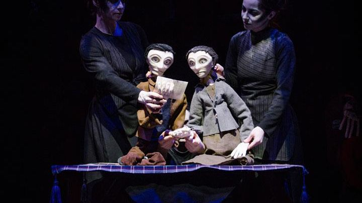 2020 Artist in Residence Dead Puppet Society. 2 cast members on stage with puppets.